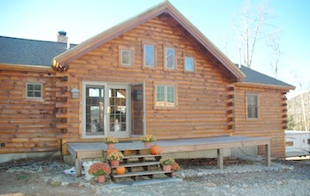 Log home deck and front door